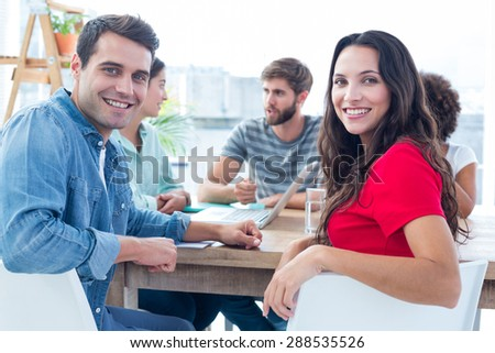 Young creative business people in discussion in the office - stock photo