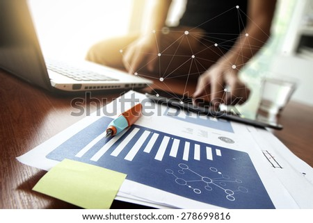 Young creative designer man working at office and social network media and graph chart diagram as concept - stock photo