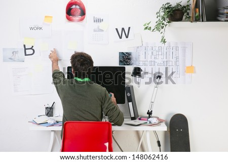 Young creative designer man working at office. / Creative man. - stock photo