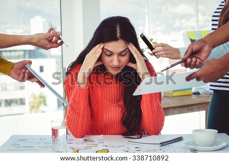 Young creative manager feeling the pressure in casual office - stock photo