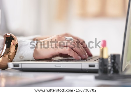 Young creative woman typing on a laptop in her office./ Close up of fashion hand's woman blogger working in a creative workspace. - stock photo