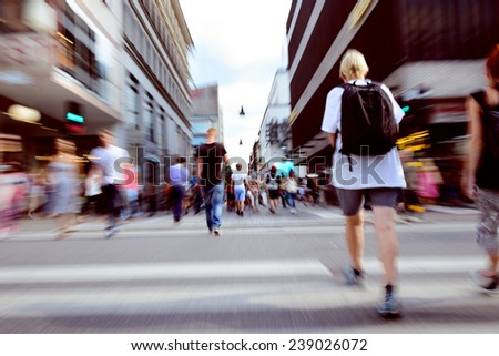 Young crowd crossing street - stock photo