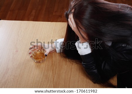 Young crying woman in depression drink drinking alcohol Dark tone image - stock photo