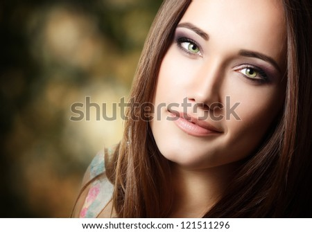 young cute beautiful woman portrait with long hair looking at camera - stock photo