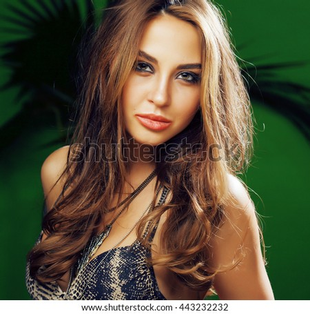 young cute blonde woman on green palm background smiling happy, lifestyle peole concept - stock photo