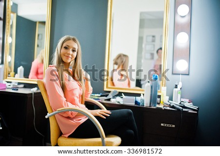 young cute bride sitting at make up salon - stock photo