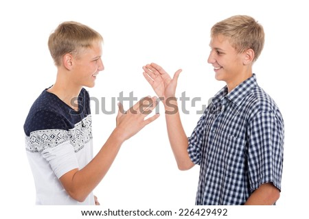 Young cute brothers greet each other hands  - stock photo