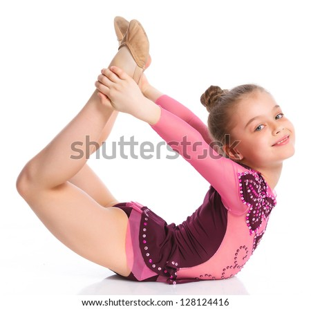 Young cute girl doing gymnastics over white background - stock photo