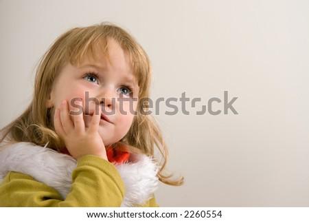 young cute girl looking upward - stock photo