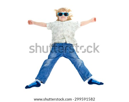 Young cute little boy to lying on the floor with blue sunglasses and smile in jeans and shirt, Isolated on white background, Positive human emotion, facial expression