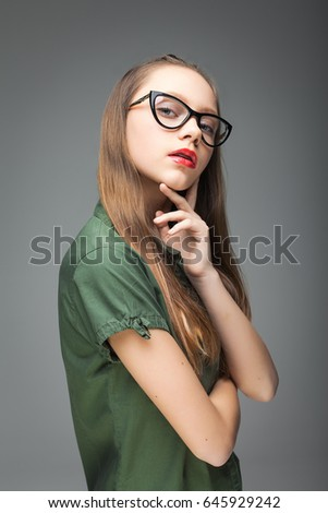 Young cute spectacled girl