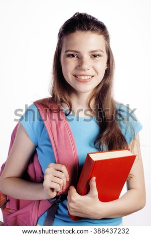 young cute teenage girl posing cheerful against white background with books and backpack - stock photo