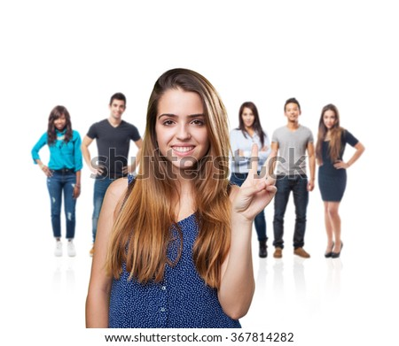 young cute woman doing a victory gesture - stock photo