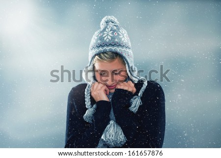 young cute woman freezing in snowstorm - stock photo