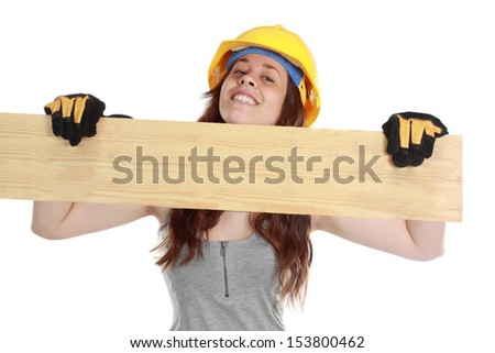 young cute woman holding a wood plank to display your message - stock photo