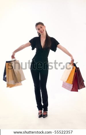 Young cute woman holding several shopping bags - stock photo