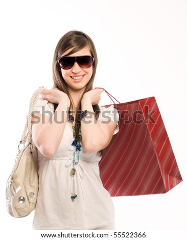 Young cute woman holding shopping bags - stock photo
