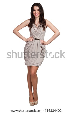 Young cute woman in beige posing on white background