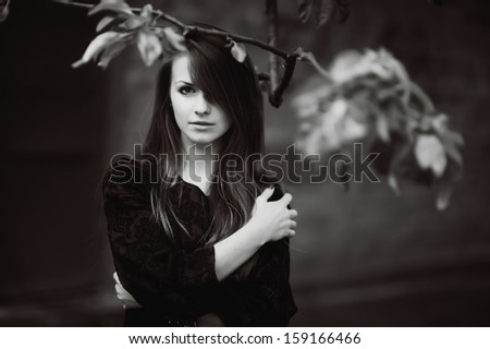 Young cute woman portrait in black and white