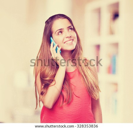 young cute woman talking on mobile on white