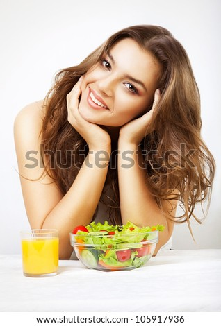 young cute woman with juice and salad - stock photo