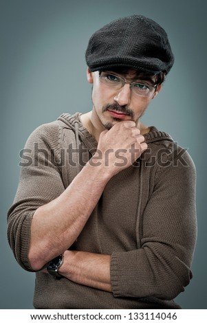 Young Cute Young Man with a Beret over a Grey Background