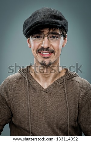 Young Cute Young Man with a Beret over a Grey Background - stock photo