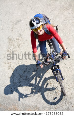 Young cyclist on a mountain bike  in the park - stock photo