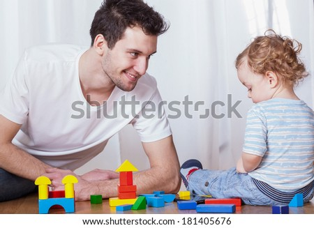 Young dad having fun with his son