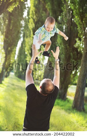 Young dad playing with his son - stock photo