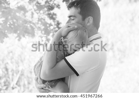 Young dad with his baby daughter  - stock photo