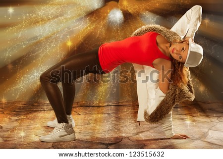 young dancer dancing under sun beams - stock photo