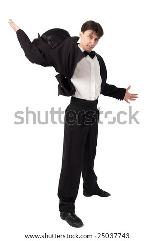 Young dancer in tailcoat standing against isolated white background - stock photo