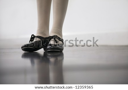 Young dancer in tap shoes... low angle shot of just feet and legs - stock photo