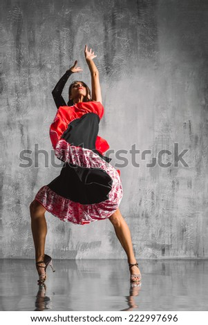 young dancer posing on studio background - stock photo
