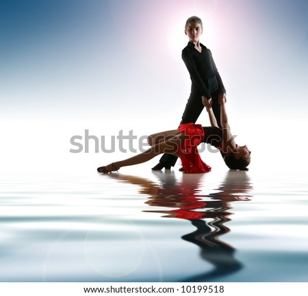 Young dancers in latin dance pose - stock photo
