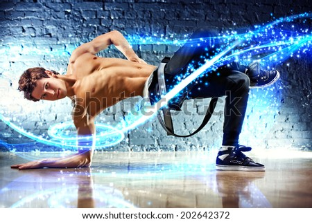 Young dancing man with light effects. - stock photo