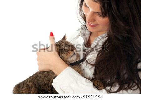 young dark hair woman vet stroking grey cat