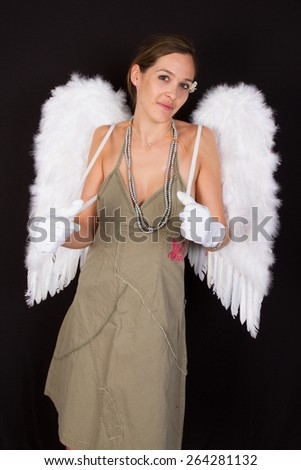 young dark-haired woman with  wings on her back - stock photo