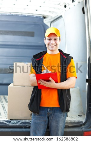 Young delivery man portrait - stock photo