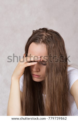 Young depressed lady between 30 and 40 years old with long straight hair