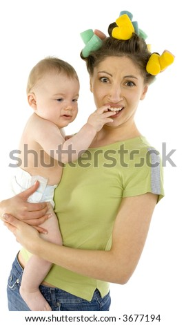 Young, depressed woman with baby on hands. Baby is putting hand in mother's mouth. Woman is looking at camera - stock photo