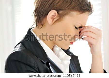 Young depresses stressed business woman at office - stock photo