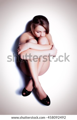 Young depression woman sitting on the floor - stock photo