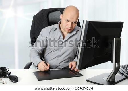 young designer does the work on your computer. - stock photo