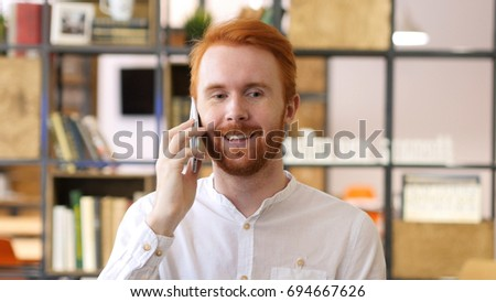 Young Designer Talking on Phone in Office