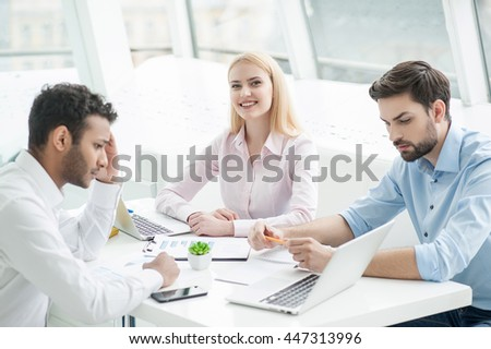 Young designers at work in office - stock photo