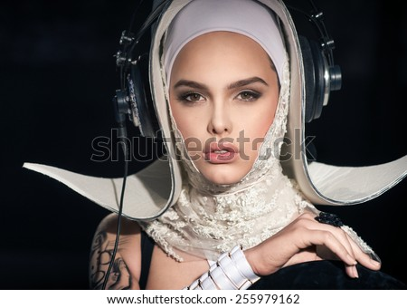 Young DJ in the form of a nun - stock photo