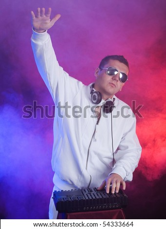 Young DJ with hand up