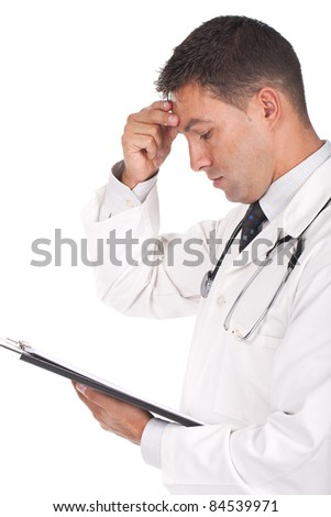 young doctor banging his head realizing a mistake and looking worried - stock photo
